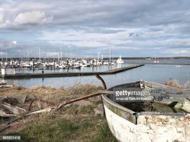 boats moored at harbor against sky - malahide stock photos and pictures