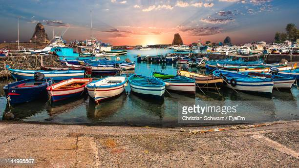 boats moored at harbor during sunset - catania stock pictures, royalty-free photos & images
