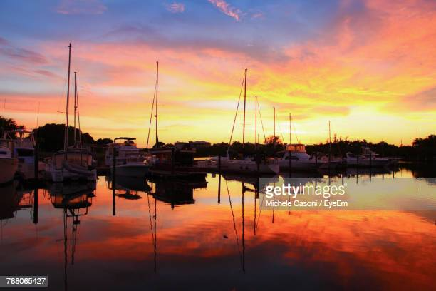boats moored at harbor during sunset - sarasota stock photos and pictures