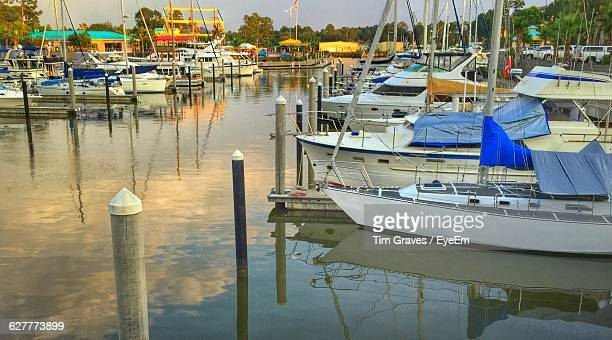 boats moored at harbor in sea - gulf shores alabama stock pictures, royalty-free photos & images