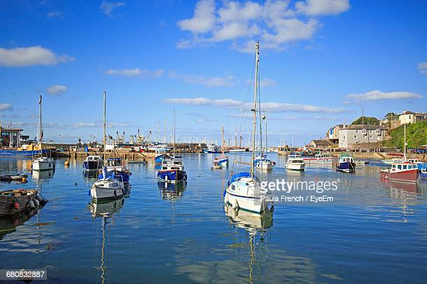 Boats Moored At Harbor In Town