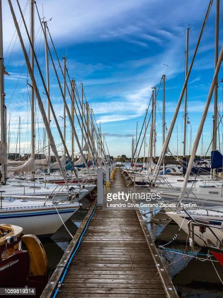 boats moored at harbor - aalborg stock pictures, royalty-free photos & images