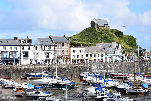 boats moored at harbor - ilfracombe stock photos and pictures