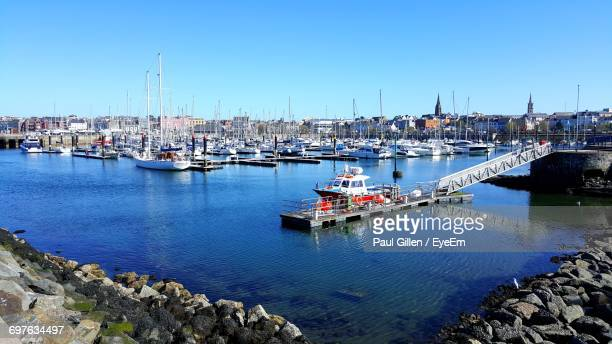 boats moored at harbor - marina stock pictures, royalty-free photos & images