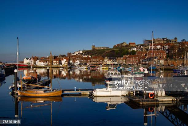 boats moored at harbor - whitby north yorkshire england stock pictures, royalty-free photos & images
