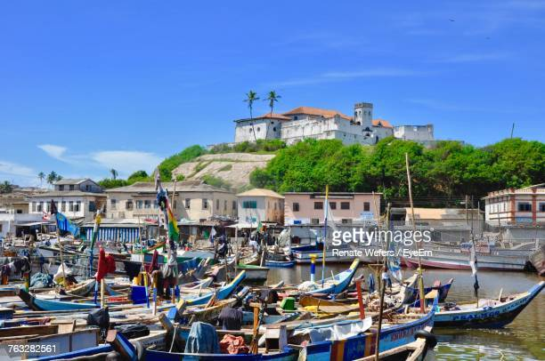 boats moored at harbor - ghana stock pictures, royalty-free photos & images