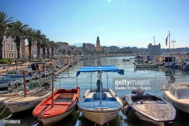 boats moored at harbor - croatia stock pictures, royalty-free photos & images