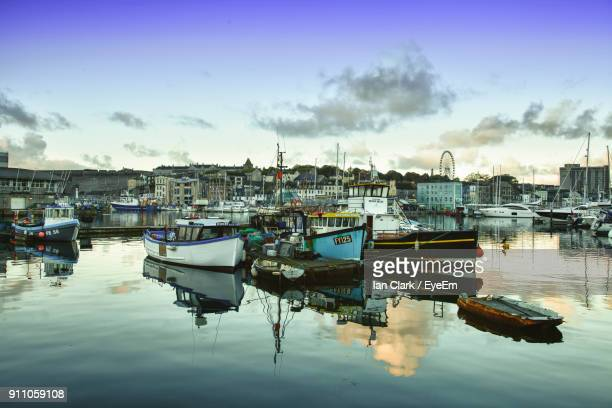 boats moored at harbor - plymouth stock photos and pictures