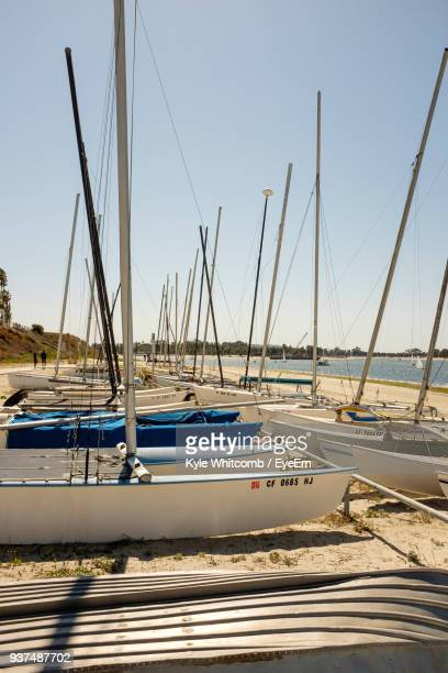boats moored at harbor - kyle ward stock photos and pictures