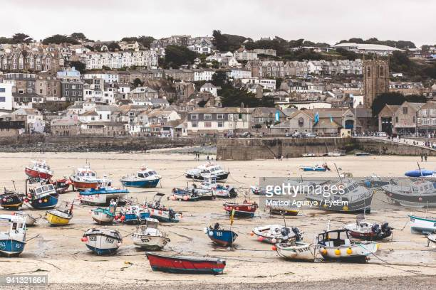 boats moored at harbor - st ives stock pictures, royalty-free photos & images