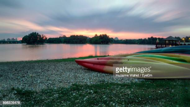 Boats Moored At Lakeshore During Sunset