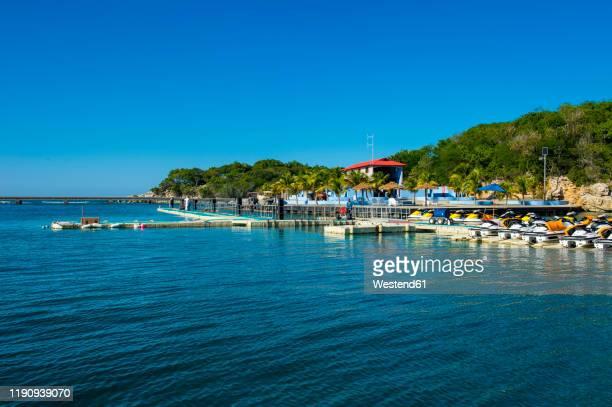 boats moored at port in labadee, haiti, caribbean - paisajes de haiti fotografías e imágenes de stock