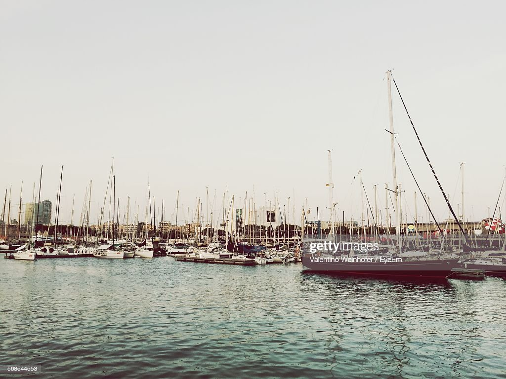 Boats Moored At River Against Clear Sky : Stock Photo