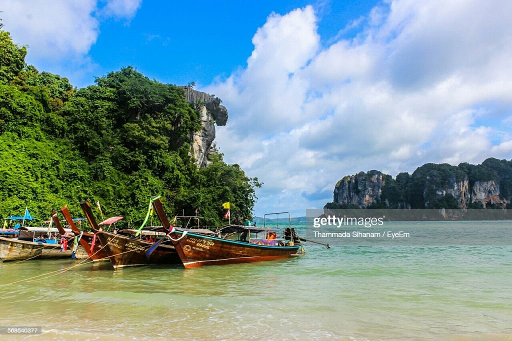 Boats Moored At Shore Against Cloudy Sky : Stock Photo