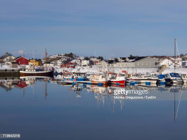 boats moored at shore against sky - monika gregussova stock pictures, royalty-free photos & images