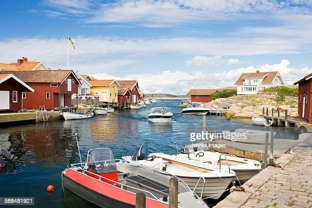 boats moored at small harbor - schweden stock-fotos und bilder