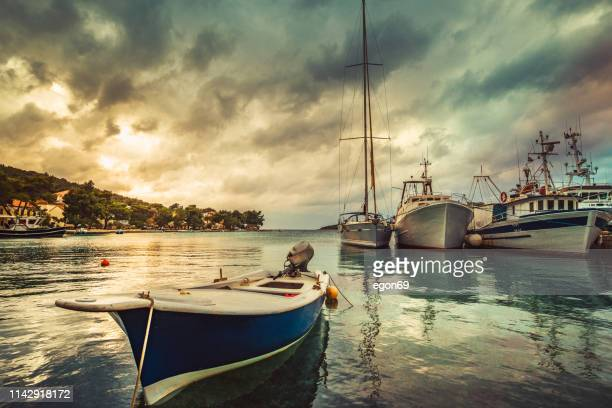 boats moored at small marina - moored stock pictures, royalty-free photos & images