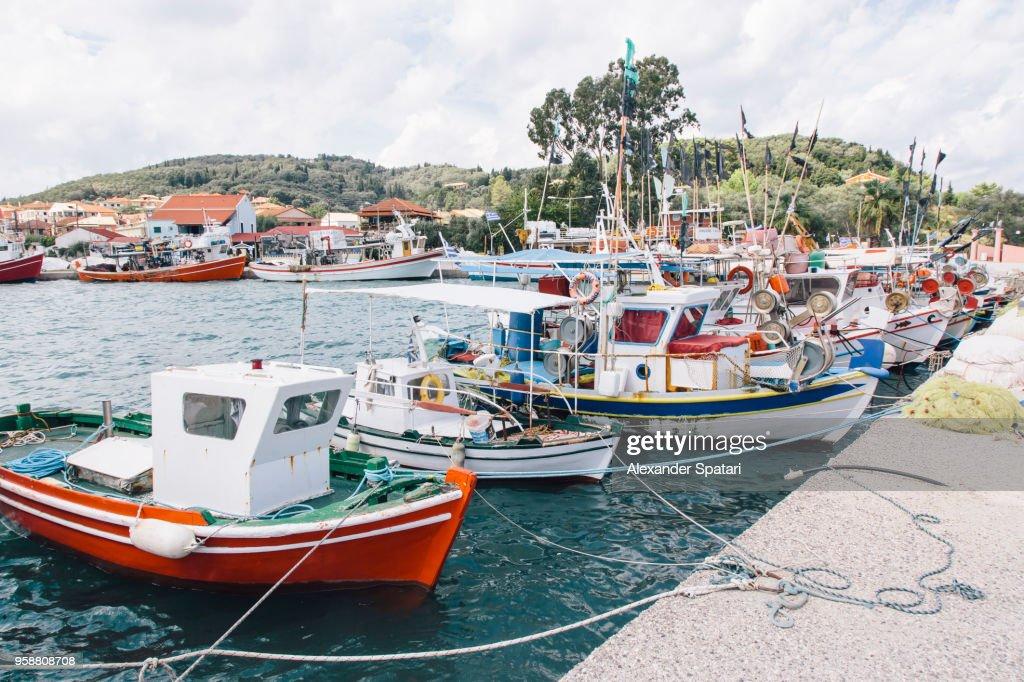 Boats moored at the harbor in fishing village Petriti on Corfu island, Greece : Stock Photo