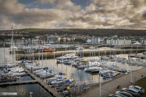 Boats moored at the harbor in Whitehaven, U.K., on Monday, Feb. 8, 2021. The U.K. Government backed the new mine which is expected to receive...