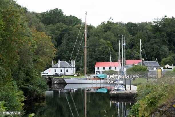 Boats moored at the sea locks gate fourteen near the entrance to the Crinan Canal on August 19, 2021 in Crinan, Scotland. Passage along the canal has...