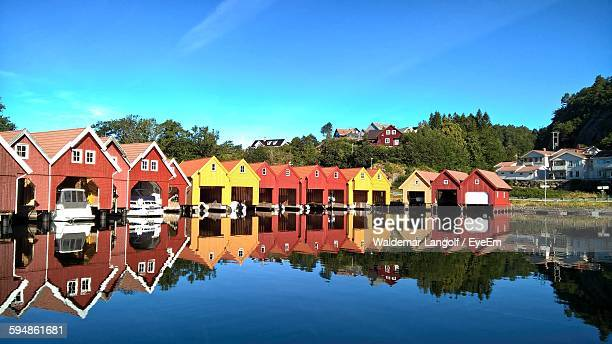 boats moored by lake against blue sky - gustav vigeland sculpture park stock pictures, royalty-free photos & images