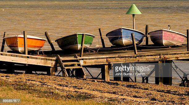 boats moored by the lake - southend on sea stock pictures, royalty-free photos & images