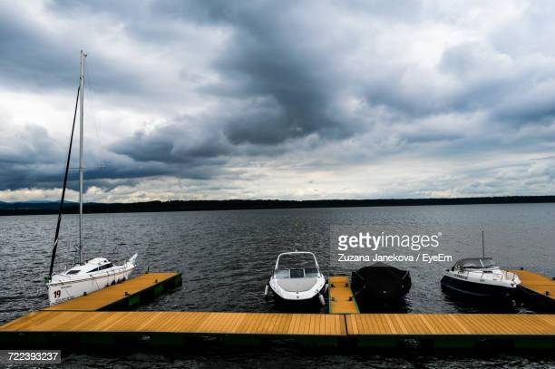 boats moored in calm lake - zuzana janekova stock pictures, royalty-free photos & images