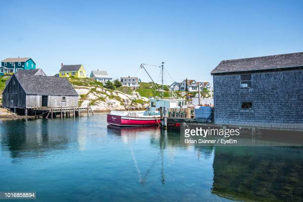 boats moored in canal by buildings against sky - halifax nova scotia stock pictures, royalty-free photos & images