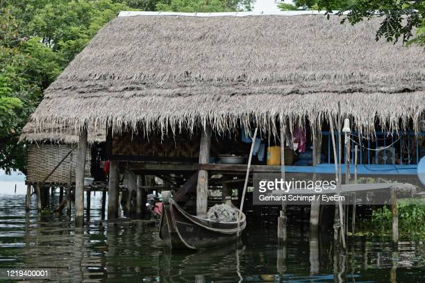 boats moored in canal by house - gerhard schimpf stock pictures, royalty-free photos & images