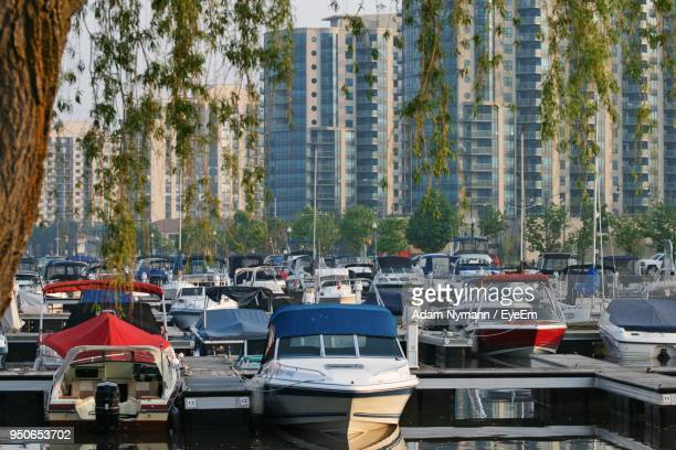boats moored in city - barrie stock pictures, royalty-free photos & images