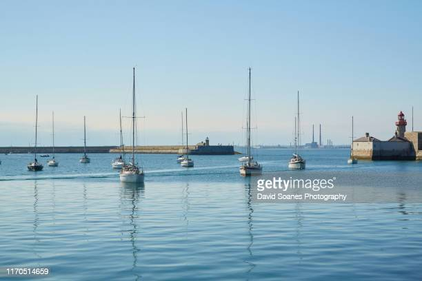 boats moored in dun laoghaire harbour in dublin, ireland - david soanes stock pictures, royalty-free photos & images