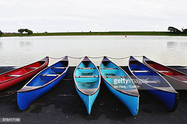 Boats Moored In Front Of Lake Against Sky