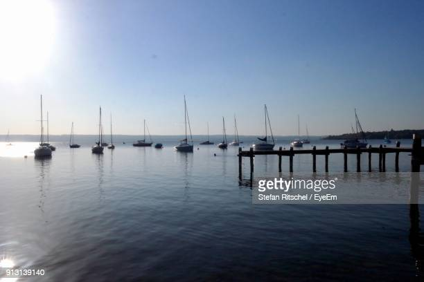 Boats Moored In Harbor Against Clear Sky