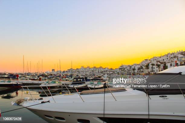boats moored in harbor at sunset - marbella stock pictures, royalty-free photos & images