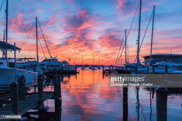boats moored in harbor at sunset - annapolis stock pictures, royalty-free photos & images