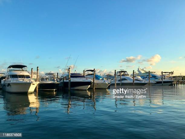 boats moored in harbor - moored stock pictures, royalty-free photos & images