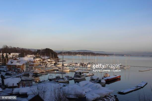 Boats Moored In Lake Against Clear Sky