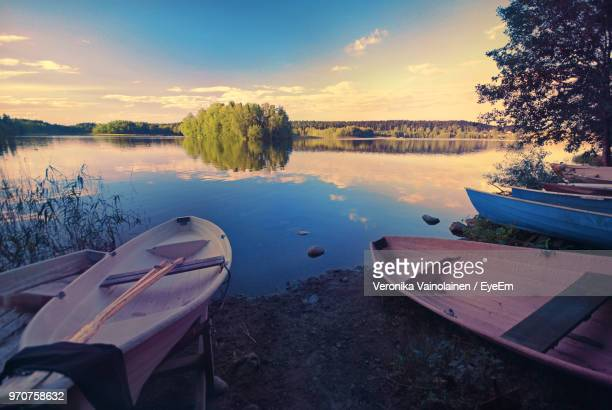 boats moored in lake against sky during sunset - tampere finland stock pictures, royalty-free photos & images