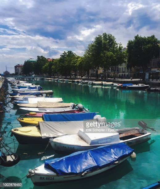 boats moored in lake against sky - rijeka stock pictures, royalty-free photos & images