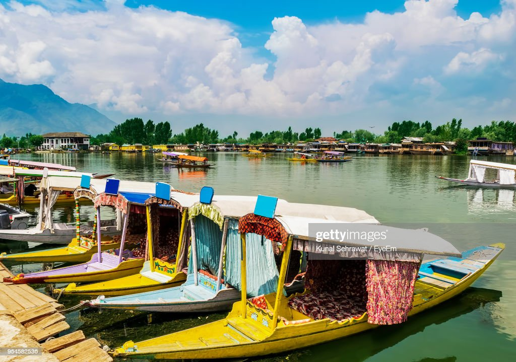 Boats Moored In Lake Against Sky : Stock Photo