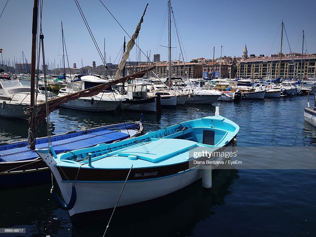 Boats Moored In Old Port Of Montreal Against Sky : Stock Photo