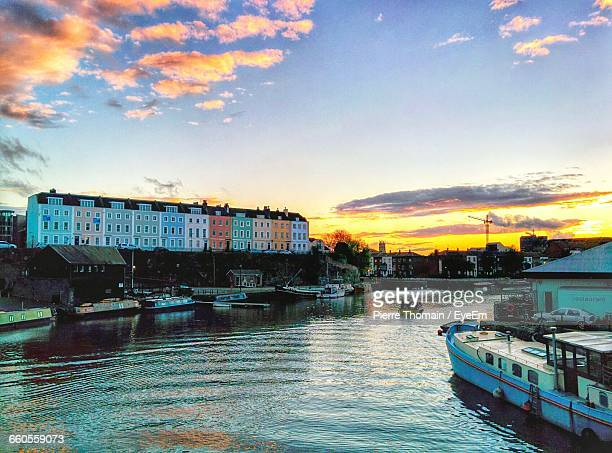 boats moored in river against built structures - bristol stock photos and pictures