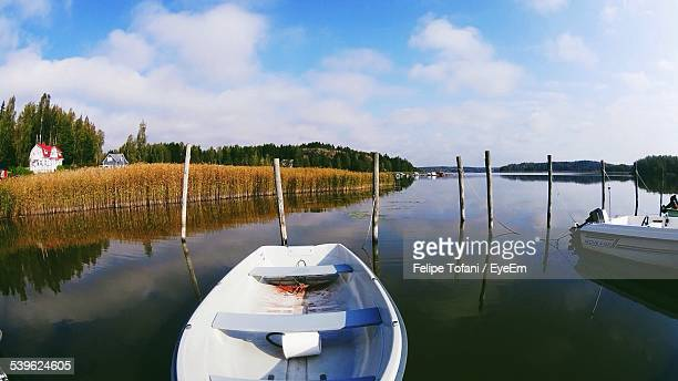 Boats Moored In River Against Sky