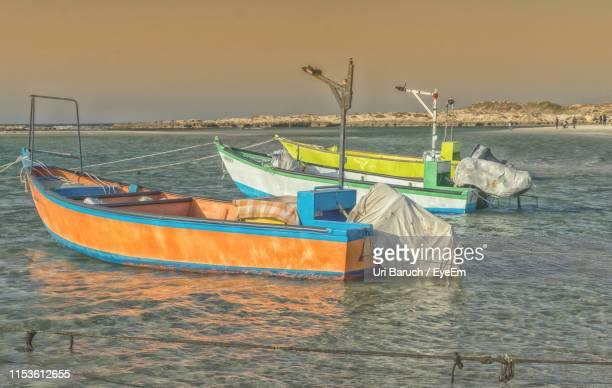 boats moored in sea against clear sky - barulho stock pictures, royalty-free photos & images