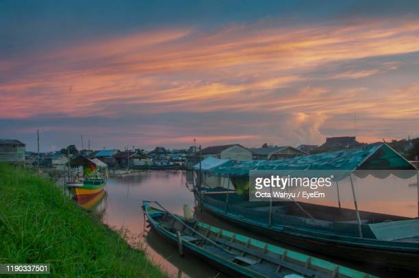 boats moored in sea against sky during sunset - central kalimantan stock pictures, royalty-free photos & images