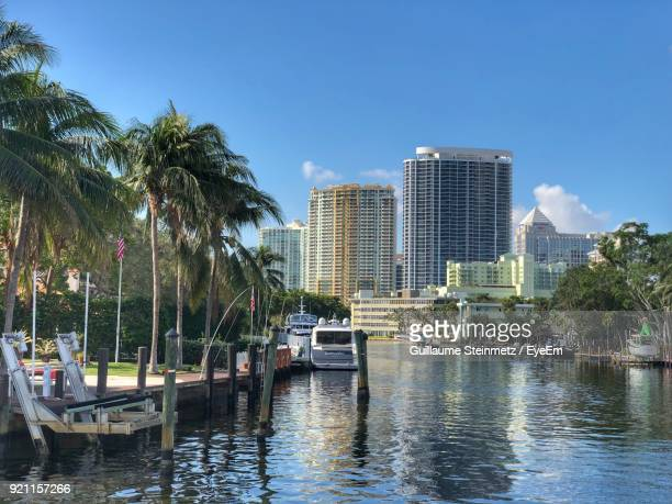 boats moored in sea against sky - fort lauderdale stock pictures, royalty-free photos & images
