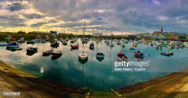 boats moored in sea - penzance stock pictures, royalty-free photos & images