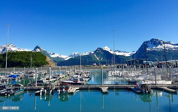 Boats Moored In Valdez Harbor In Front Of Mountains