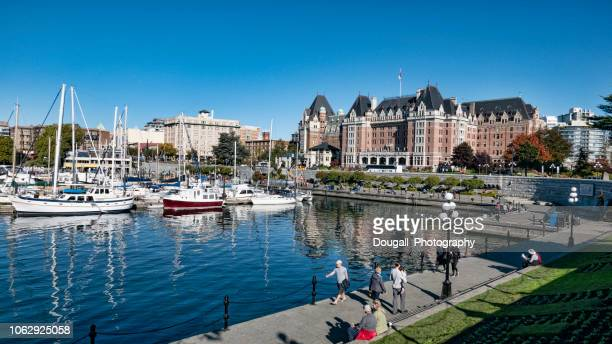 boats moored in victoria inner harbor - british columbia stock pictures, royalty-free photos & images