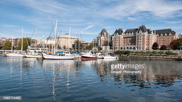 boats moored in victoria inner harbor - victoria canada stock photos and pictures